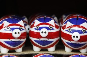 A row of piggy banks adorned with the colours of Britain's Union Jack flag are displayed in a souvenir shop in London